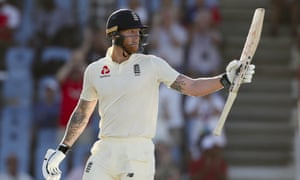 England's Ben Stokes raises his bat after reaching a half-century against West Indies on a day when the tourists' top order again struggled.