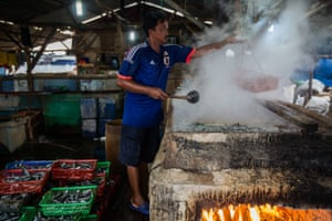 A workers at a salted fish processing business in Muara Angke.