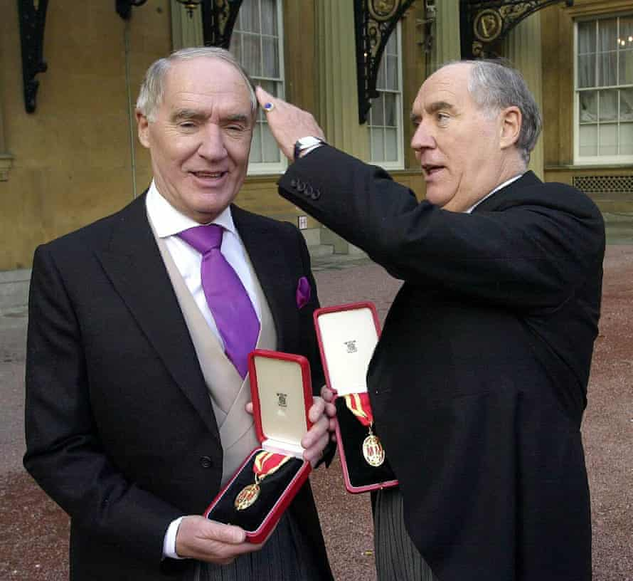 Sir David Barclay (left) and his twin brother, Sir Frederick Barclay, after receiving their knighthoods from the Queen at Buckingham Palace.