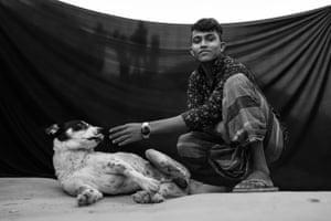 Fifteen-year-old Jamir* with his dog Shirkari