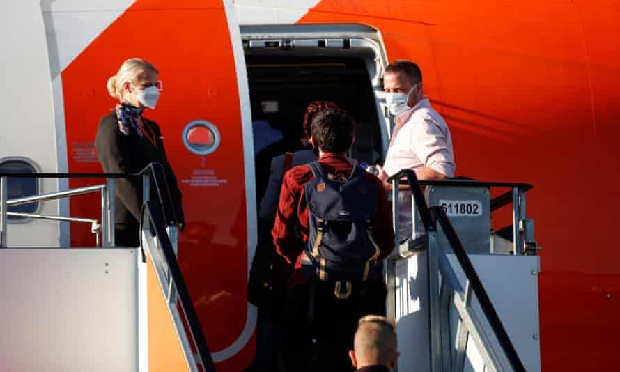Masked EasyJet flight attendants