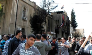 Demonstrators outside a courthouse in Deraa, Syria in 2011