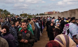 Syrian refugees await registration at the UNHCR compound in Tripoli