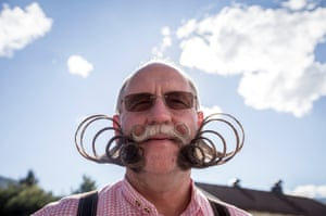 A contestant of the World Beard And Mustache Championships poses for a picture during the opening ceremony of the Championships 2015