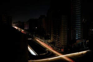 Car lights illuminate a junction
