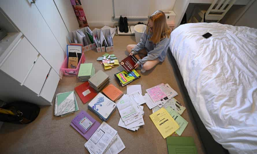 A Year 11 student ponders over her school books and revision materials after the premature end to her school year.