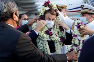 France's President Emmanuel Macron is welcomed at Faa'a international airport, Tahiti