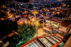 Comuna 13 by night. Tour guide Garcia says: 'Before, we had to hide that we lived in La 13, today we can say with pride that it's where we're from.'