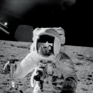 Alan Bean holds a container filled with lunar soil in a picture taken by Pete Conrad.