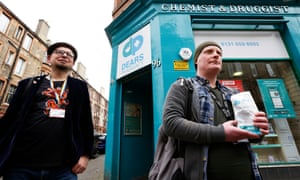 Rab Dylan (right) and Lucas Waclawski collect a methadone prescription from a pharmacy in Edinburgh