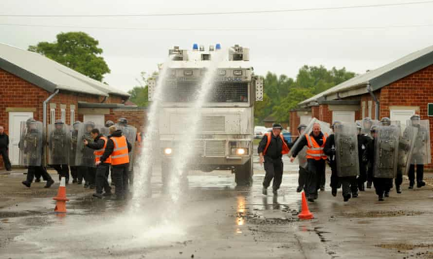 Officers training with a water cannon.