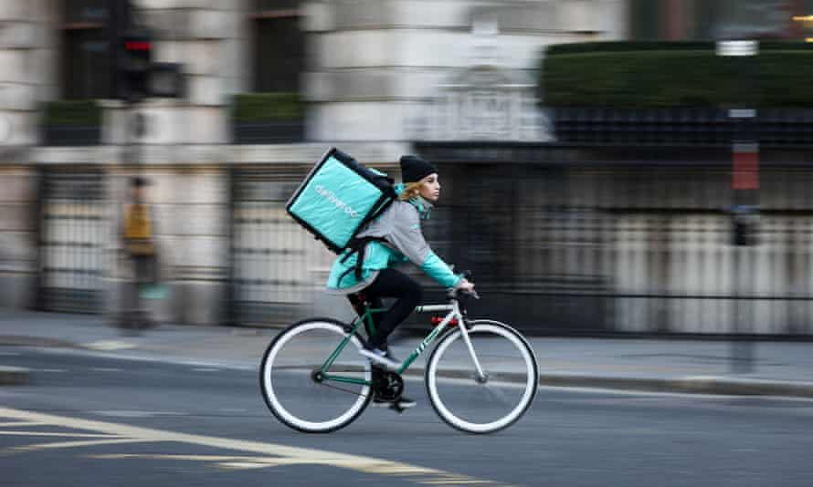 A Deliveroo rider on the road in London.