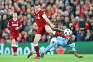 Jordan Henderson wins the ball ahead of Fernandinho as Liverpool look to close out the match.