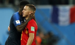 Belgium's Eden Hazard is consoled by France's Samuel Umtiti after the final whistle.