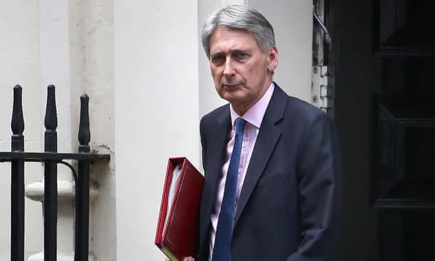 Chancellor Philip Hammond leaving 11 Downing Street in London.