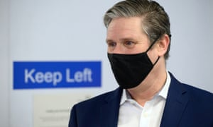 The Labour party leader, Keir Starmer, speaks to medical staff during a visit to Whittington hospital in London last month. Photograph: Leon Neal/Reuters