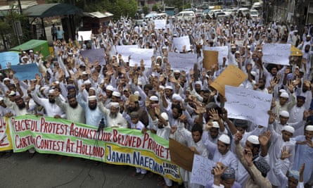 Teachers and students at an Islamic seminary in Lahore protest against a cartoon contest planned by the Dutch politician Geert Wilders.