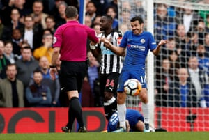 Chelsea's Pedro reacts with referee Kevin Friend during Chelsea 3-0 win over Newcastle at Stamford Bridge.