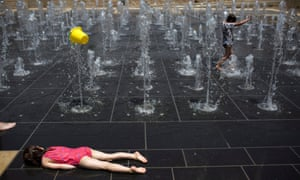 Young children playing in a fountain during a heatwave