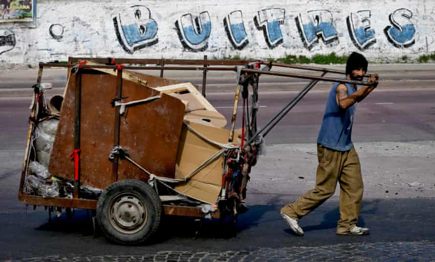 A littler picker in Buenos Aires pushes a cart full of recyclables. Recently, the Argentinian capital has made efforts to invest in recycling programs with the aim to reduce the amount of solid waste that ends up in landfill.