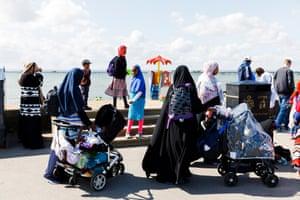 Muslim women with pushchairs on promenade