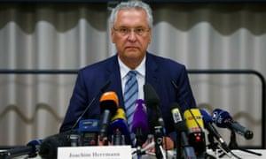 Bavarian interior minister Joachim Herrmann addresses the news conference in Ansbach.