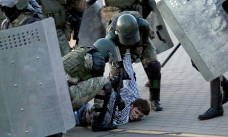 Law enforcement officers detain a man during an opposition rally to protest against the presidential inauguration in Minsk, Belarus.