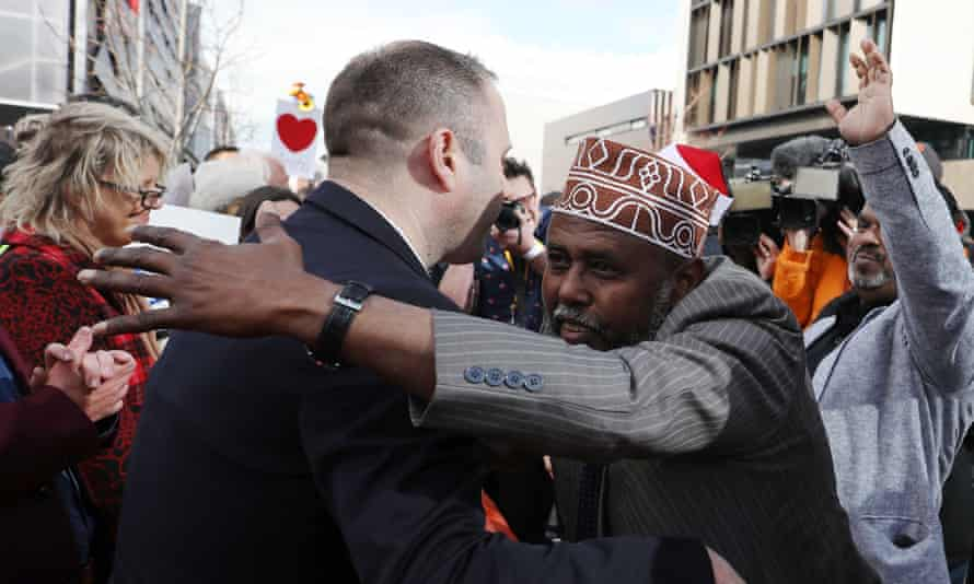 Mohamed Jama, Muslim Association Canterbury, celebrates with members of the public after the judgement and the last day of the sentencing for Australian white supremacist Brenton Tarrant in Christchurch on August 27, 2020.