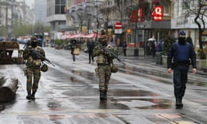 Soldiers patrol in central Brussels after security was tightened in Belgium.