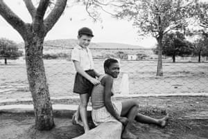 A farmer's son with his nursemaid, Heimweeberg, Nietverdiend, Western Transvaal, 1964