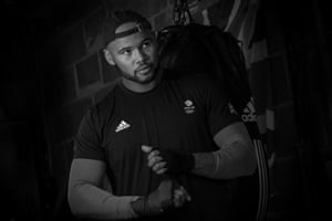 Super heavyweight boxer Frazer Clarke taping up at his home in October 2020.