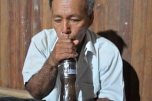 Sina Ramirez Rios, a Shipibo curandero, 'singing' to ayahuasca before a ceremony near Pucallpa in Peru's Amazon.