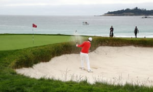 Justin Rose plays a shot from a bunker