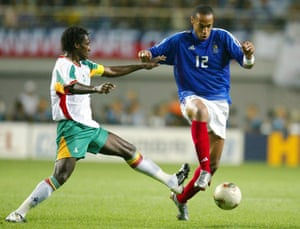 Cissé challenges Thierry Henry during Senegal's famous win in 2002.
