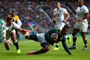 Sibusiso Nkosi goes over the line to score.