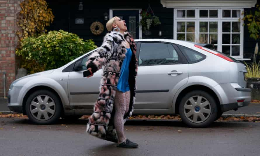 a woman in a fur coat screaming in the street