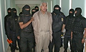 Members of the Mexican federal preventive police guard Rafael Caro Quintero in Guadalajara, Jalisco, on 27 January 2005.