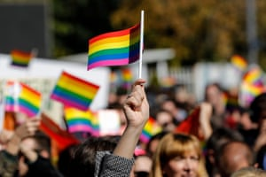 Participants wave rainbow flags at an LGBT rights groups parade