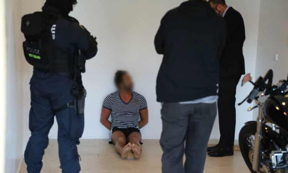 Police arrest a man in Kellyville in Sydney's northwest on Friday following a series of raids by NSW police and the FBI into alleged drug trafficking and money laundering.