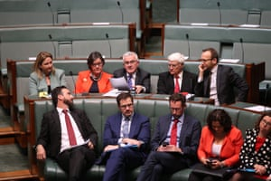 The crossbench independents sit together during a division to bring on debate on the banking and financial services commission of inquiry bill