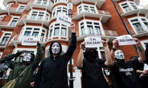 Demonstrators in Guy Fawkes masks outside the Ecuadorian embassy in Knightsbridge in August 2012