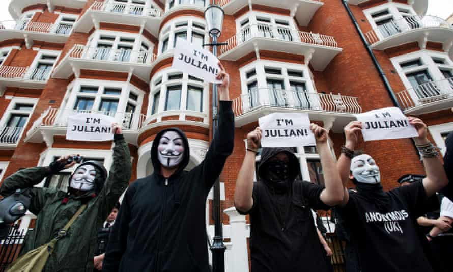 Demonstrators in Guy Fawkes masks outside the Ecuadorian embassy in Knightsbridge in August 2012