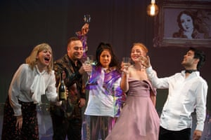 Five actors hold up wine glasses to a toast