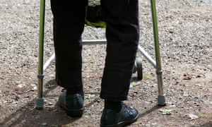 An elderly person with a walking frame.