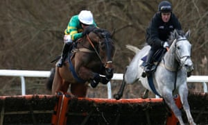 Tony McCoy was back on the racecourse at Kempton on Friday, riding Hargam in a workout with his mount's fellow Champion Hurdle hope My Tent Or Yours, left.