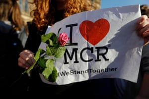 Candlelit Vigil To Honour The Victims Of Manchester Terror Attack(170523) -- MANCHESTER, May 23, 2017 (Xinhua) -- A young girl holds up a sign and a flower during a candlelit vigil to honour the victims of Monday evening's terror attack, at Albert Square in Manchester, Britain on May 23, 2017. (Xinhua/Han Yan) PHOTOGRAPH BY Xinhua / Barcroft Images London-T:+44 207 033 1031 E:hello@barcroftmedia.com - New York-T:+1 212 796 2458 E:hello@barcroftusa.com - New Delhi-T:+91 11 4053 2429 E:hello@barcroftindia.com www.barcroftimages.com