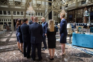 Staff members meet in the lobby of the Trump International Hotel just after it opened.