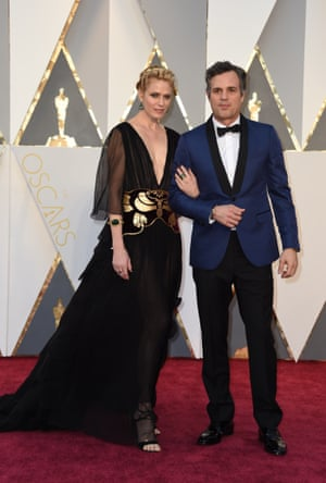 Actor Mark Ruffalo and his wife Sunrise Coigney. Ruffalo's gone red carpet edgy with his blue tux with with black trimming. The less said about his lovely wife's wrestling medal belt the better though. So we're not saying anything.