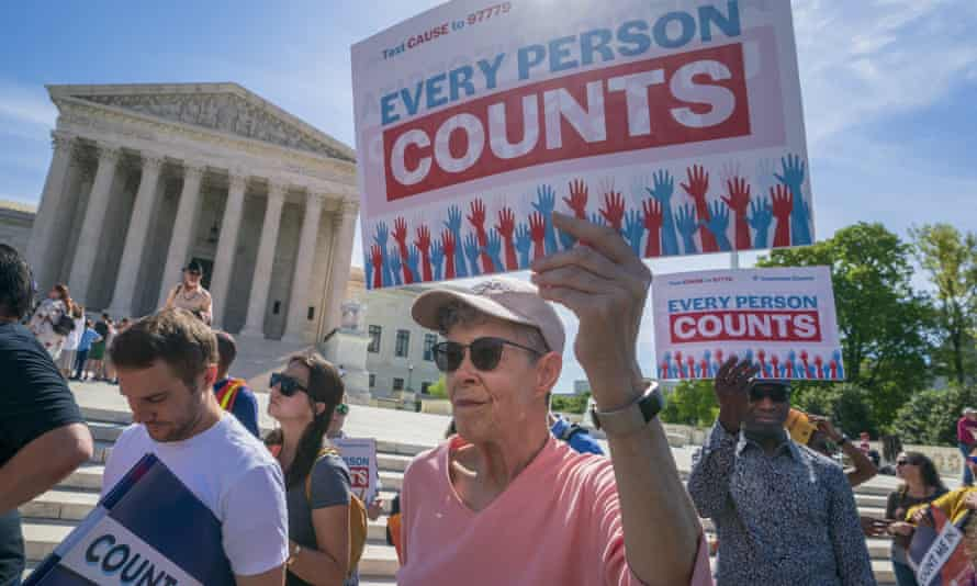 Immigration activists rally outside the supreme court as the justices hear arguments over the Trump administration's plan to ask about citizenship on the 2020 census, on Tuesday.