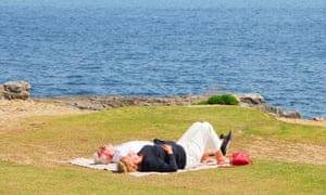 Sunbathers enjoy the sunshine at Portland Bill in Dorset